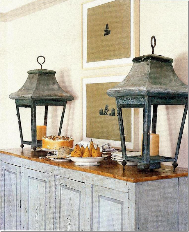 Antique lanterns on a blue painted antique console in a Swedish dining room by Jane Moore found on Hello Lovely Studio.