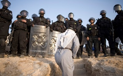 A resident of Al Araquib is blocked from entering his home by riot police.<br />The Israeli authorities demolished the entire village of Al Araquib in which 300 residents live.<br />30 homes, infrastructure and animal pens were demolished.<br />Residents of unrecognised villages are unable to get building permits for their houses.