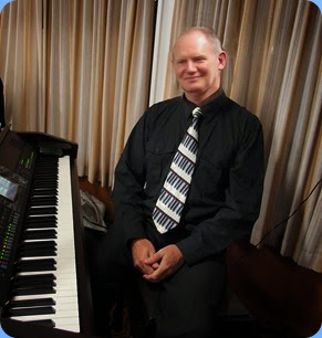 Band leader, Dave Hallam, setting-up to play the Club's Clavinova. Photo Courtesy of Dennis Lyons.