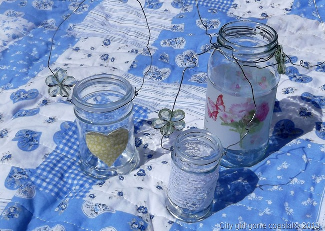 decorated jars with wire hangers