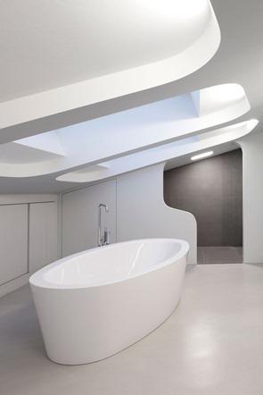 baño-minimalista-bañera-ovalada