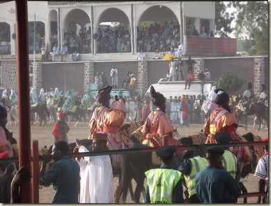 the parade with palace and spectators behind