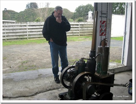 Derek examining a Pratt single cylinder 2 stroke engine.