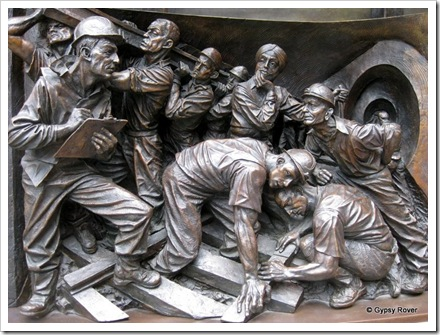 A statue depicting St Pancras station over the decades. The gangers who kept the railways moving.