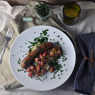 Roasted Sausages with Grapes and Creamy Pearl Couscous 'Risotto'.
