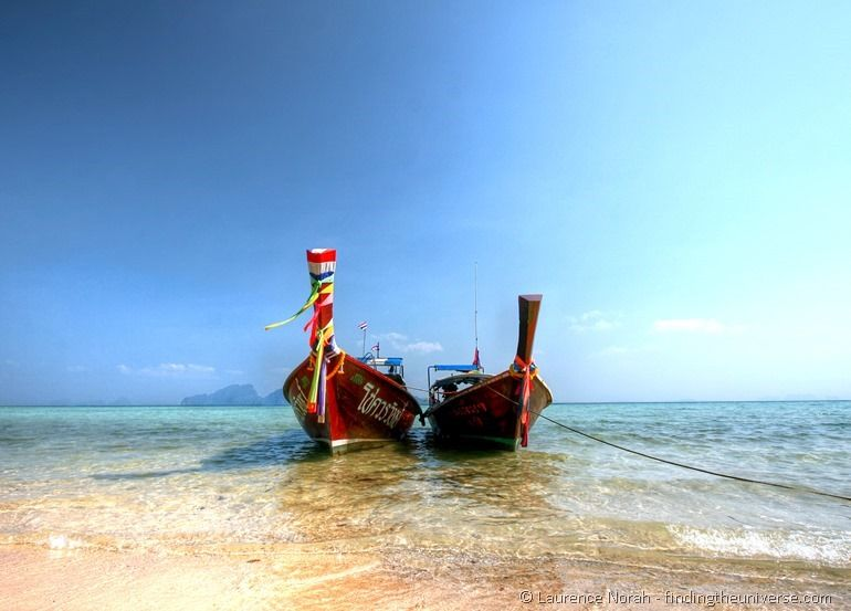 Two long tail boats Koh Kradan beach thailand