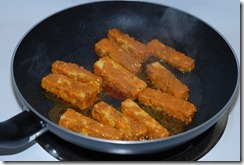 Shallow-fry paneer until golden brown on both sides