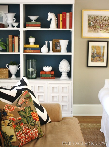 white bookcases with painted blue back