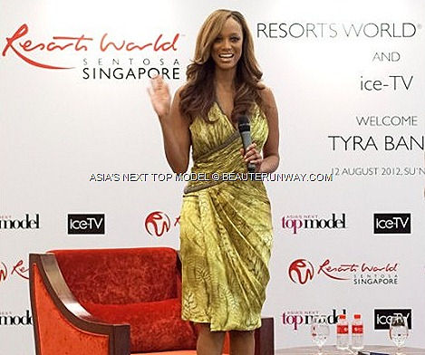 TYRA BANKS SINGAPORE ASIA'S NEXT TOP MODEL Supermodel IN  America's Next Top Model creator, host executive producer EQUARIUS HOTEL RESORTS WORLD SENTOSA Carlos Miele bright yellow grey silk dress sky-high nude platform heels