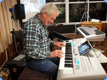 Denis Stewart playing his Yamaha Tyros 4. Photo courtesy of Dennis Lyons