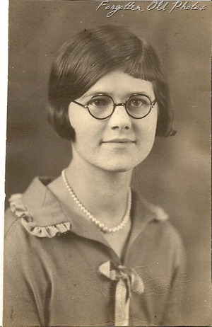 Girl with dark rimmed glasses