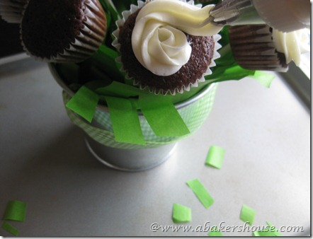 Keep swirling around the icing to frost the cupcake like a rose