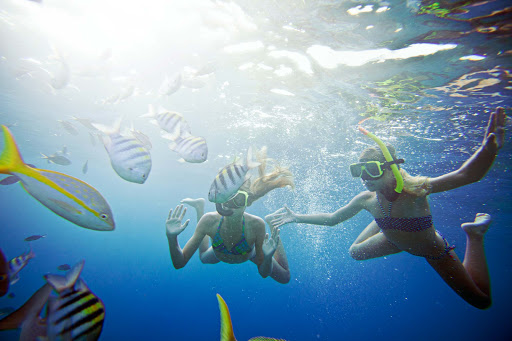 Curacao-snorkeling-girls - Kids and adults love the underwater sights while snorkeling in Curacao.
