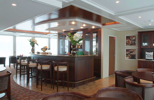 Guests can unwind after a day of sightseeing along the rivers of western Europe with a cocktail in the Panoramic Lounge Bar aboard AmaDagio.