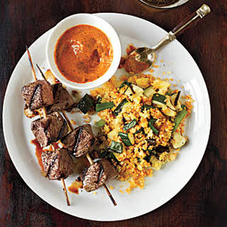 Sirloin Skewers with Grilled Vegetable Couscous and Fiery Pepper Sauce.