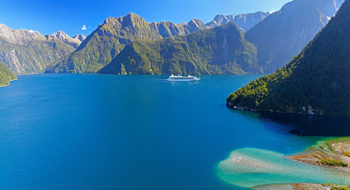 Milford_Sound_ - As a passenger on a cruise ship, you'll get the ultimate view of Milford Sound. Make yourself comfortable on the promenade deck and just drink it all in. What you're seeing is the work of successive ice ages, when huge glaciers carved paths to the sea.