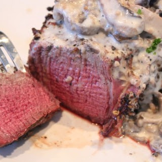 Peppercorn Steaks with White Wine Mushroom Cream Sauce.