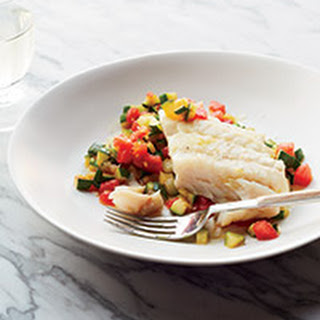 Olive Oil-Poached Hake on Sautéed Zucchini with Tomatoes.