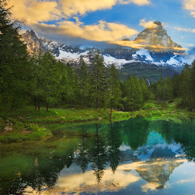 matterhorn sunrise by Ennio Pozzetti - Landscapes Mountains & Hills ( mirror, clouds, blue lake, cervinia, lago blu, reflections, matterhorn, lake, sunrise, cervino, italy,  )