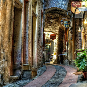Walking in Dolceacqua by Roberta Sala - City,  Street & Park  Street Scenes ( dolceacqua, street, street scene, italy, street photography )