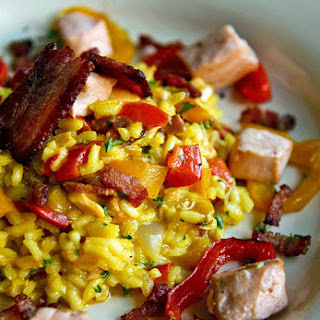 SALMON RISOTTO with bell peppers, bacon and zafferano