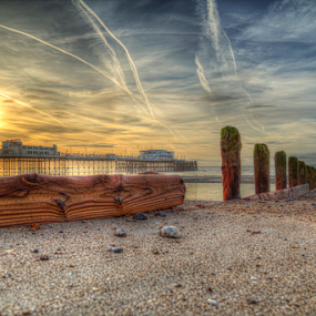 worthing pier by Peter Wyatt - Landscapes Sunsets & Sunrises ( water, driftwood, sussex, sunset, worthing, pier, pebbles, seascape, sunrise, seaside, landscape,  )