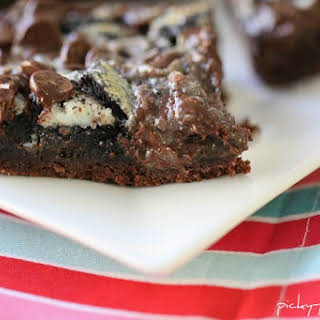 Gooey Cookies and Cream Double Chocolate Cake Bars.