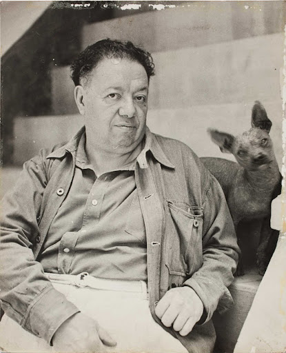 Diego Rivera with a xoloitzcuintle dog in the Blue House, Coyoacan