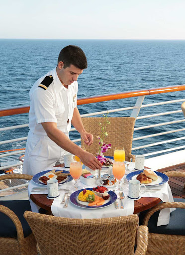 Service-by-crew-SeaDream - A crew member prepares breakfast for guests during a SeaDream cruise.