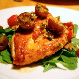Flattened Chicken with Tomato-Saffron Vinaigrette on Arugula