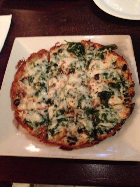 Gluten Free Veggie Pizza with garlic and spinach.