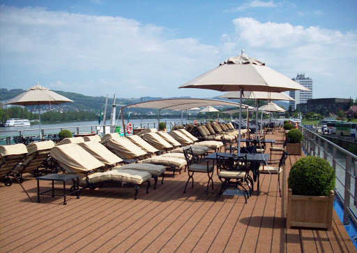 Uniworld-River-Beatrice-sundeck-lounges - Recline on a sun lounge up on the deck of the River Beatrice cruise ship as you sail past historic and scenic points of interest along the Danube River.