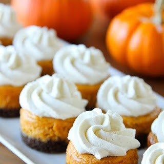 Mini Pumpkin Cheesecakes with Gingersnap Crusts.