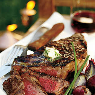 Grilled Rib-Eye Steaks with Parsley-Garlic Butter.