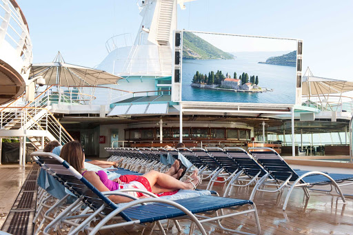 Grandeur-of-the-Seas-outdoor-screen - Watch family-friendly feature films and sporting events on Grandeur of the Seas' 220-square-foot poolside outdoor screen.