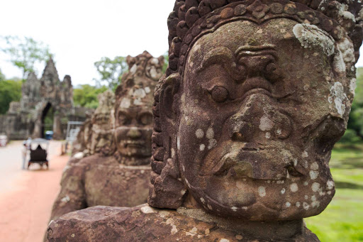 A stone sculpture at Angkor Wat — a United Nations World Heritage Site and the largest religious monument in the world — seen during a G Adventures expedition of Cambodia.