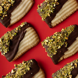 Chocolate-Dipped Spritz Washboards with Pistachios.