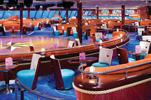 Norwegian-Pearl-Spinnaker-Lounge - Let Norwegian Pearl's Spinnaker Lounge put you in a partying mood with its hip interiors and dance floor.