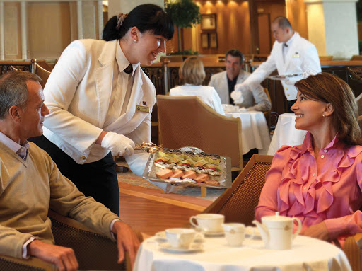 Enjoy a cup of soothing afternoon tea while cruising aboard Queen Elizabeth.