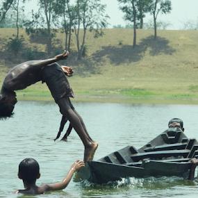 Rejoicing Dive by Rupam Chakraborty - Babies & Children Children Candids ( water, season, street, children, candid, people )