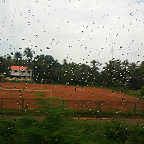 rain train by Vahidha Azad - Instagram & Mobile Android ( glass, train, rain )