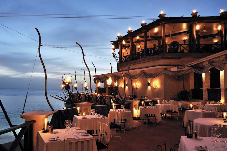 For a romantic dinner with an enchanting view, head to the Cliff Restaurant in Durants, Barbados.