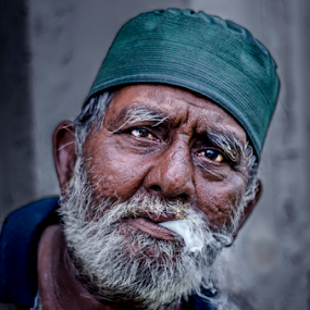 Struggling for life by Mohammad Khairizal Afendy - People Portraits of Men ( help, struggle, poor, close up, cigerette, smoke, man )