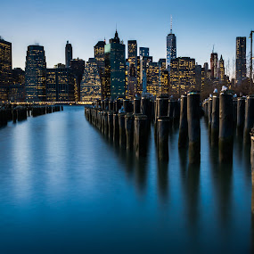 Manhattan Skyline by James Vodicka - City,  Street & Park  Skylines ( jvodicka, old, america, travel, nyc, james vodicka, architecture, cityscape, jetty, usa, city, lights, pier, long exposure, manhattan skyline, new york skyline, lightspylons, manhattan, new york, dusk, blue, brooklyn bridge park, sunset, nikon d5200, night, new york city, brooklyn,  )