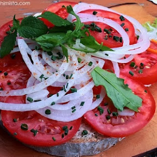 Rye Bread with Malga Butter, Tomatoes, and Onions