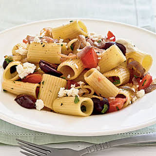 Pasta with Caramelized Onions, Tomatoes, Parsley, and Olives.