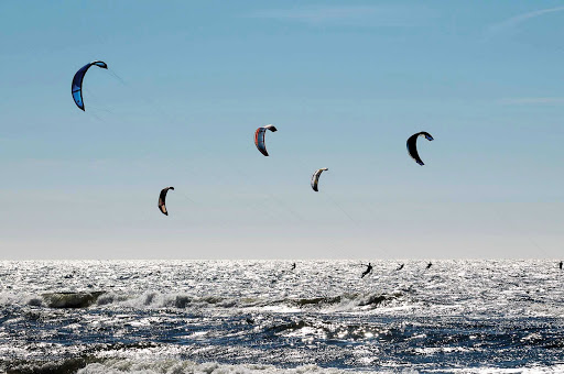 Kite surfers along the beach in Zandvoort, west of Amsterdam in the Netherlands.