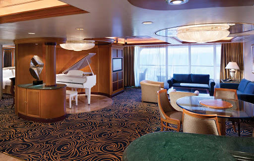 Splendour-of-the-Seas-Royal-Suite - The 1,002-square foot Royal Suite aboard Splendour of the Seas features a private balcony, baby grand piano, and a separate bedroom with king-size bed.