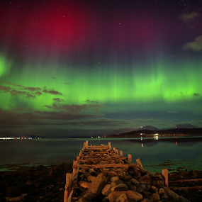 Tonight was the northern light very powerful with lots of redness - This is taken from Tromsø in northern NorwayVakkert nordlys ikveld fra Kvaløysletta - Tromsø by Geir Hammer - Landscapes Waterscapes ( nordnorge, mittnorge, sky, red, rsa_sky, green, aurora, pier, northern light, warer )
