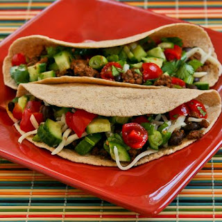 Spicy Beef and Black Bean Soft Tacos with Cucumber, Tomato, and Lime Salsa.